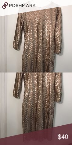 F21 gold sequin dress, scalloped detailing. Never worn. Purchased on eBay but too big for me! Pretty, muted bronzed gold color. Fully lined with soft cottony material. Three-quarter length sleeves and knee length skirt. Would be stunning for NYE. Forever 21 Dresses
