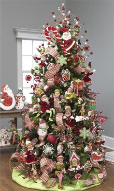 RAZ Cookie Confection Christmas Elf Tree  filled with red and green Christmas elves, Christmas cookie shapes, peppermint themed balls and sprays.  Visit our site to find items used to decorate this tree  shelley b home and holiday