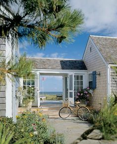 A breeze way links the garage to the house of this coastal waterfront beauty! #coachbarn #outdoorliving