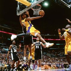 Kobe Bryant ( of the Los Angeles Lakers goes for a reverse dunk against the San Antonio Spurs, during the NBA game at the Staples Center. Basketball Pictures, Love And Basketball, Sports Pictures, Basketball Wall, Custom Basketball, Basketball Quotes, Duke Basketball, College Basketball, Nba Players