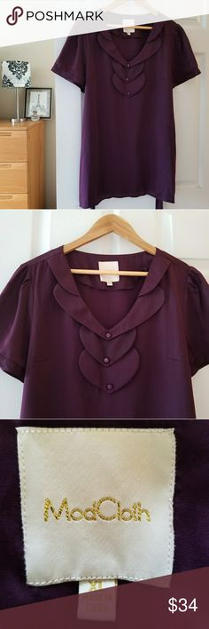 "modcloth purple short sleeve blouse size XL Such an adorable neckline on this blouse!  Measurements lying flat:  Bust: 21"" Length: 30"" 100% polyester   -Smoke-free home  -Reasonable offers welcome, but prices are firm on items under $10.  -No trades, please.  -All measurements are approximate.  💕💕💕Thank you for shopping my closet, it means a lot to me!💕💕💕 Modcloth Tops Blouses"