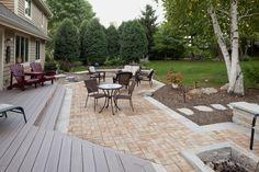 Brick patio with limestone border.  Limestone seat walls surround the individual gathering areas.
