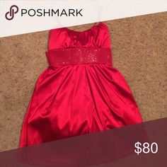 Red dress This shiny, satin dress is in the PERFECT shade of bright red. Wear it with black tights and heels to a Christmas party! Only worn once for a couple hours. From Dillard's. Dresses
