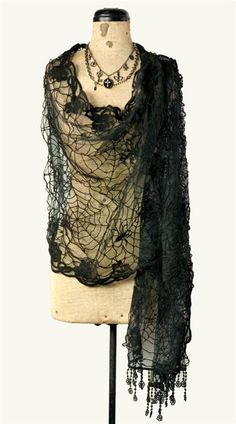 """$39.95 Patiently created in her forest studio, Miss Spider's lacework has inspired a diaphanous drape of natural beauty. Softest cotton blend. Black. 20 x 63""""."""