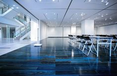 Flooring made of Japanese cedar stained with indigo dye at the Tokushima City Library Gallery © Dairi Lumber Co. Iris Soul Indigo Tile p stk Blue Wood Stain, Cedar Stain, Cedar Wood, Mood Indigo, Indigo Dye, Luxury Vinyl Tile, Luxury Vinyl Plank, Vinyl Flooring, Plank Flooring