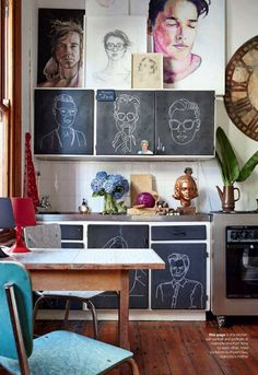 And finally, from Poppytalk, a couple of images from a beautiful and funky South African home. The chalkboard-painted doors in the kitchen add a funky touch, and the chalkboard-painted fireplace wall (with swirly script) is surprisingly sophisticated.