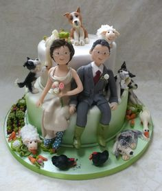 Round Wedding Cakes - Really enjoyed making this alternative wedding cake. Not only has the farmer got a wife, he's also got five dogs, couple of geese, a few chickens and some carrot munching sheep!