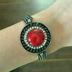 """3 LEFT🆕✨HP✨REDTURQUOISE LG.CIRCLE STONE BRACELET BEAUTIFUL LARGE RED TURQUOISE CIRCLE STONE BANGLE BRACELET.  INTRICATE DETAILING IN THE SILVER BRACELET, FINISHED OFF WITH GORGEOUS FAUX  DIAMONDS , MEASURES APPX 9"""" FROM CLASP TO LAST HOLE. GREAT TO WEAR AS A FLATTERING STATEMENT PIECE, OR MIX W/ OTHER BRACELETS,  I PERSONALLY ?THESE 2 PAIRED TOGETHER. MADE W/ HIGH QUALITY METALS MATERIAL CONTENT : 18K PLATED METALS & NICKEL & LEAD FREE. ✨HP BACK 2 BASICS 6/22/16✨❤ @molinda25 ✔BUNDLE 3 GET…"""