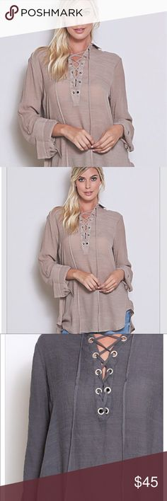 "Gorgeous taupe Lace up blouse Gorgeous Taupe long sleeve Lace up blouse. 100% polyester women's sizes Bust; S-20"" M-21"" L-22"" Length S-31"" M-32"" L-33"" Angelique's Atelier Tops Blouses"
