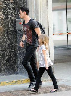 Maksim wore all black with daughter Leeloo