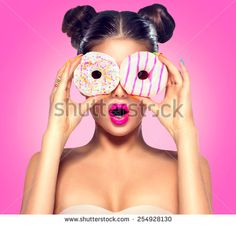 Beauty fashion model girl taking colorful donuts. Funny joyful woman with sweets, dessert. Diet, dieting concept. Junk food, Slimming, weight loss - stock photo