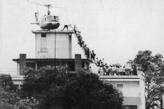 Last day in Saigon: Iconic UPI photo heralded end of Vietnam War - UPI.com -- An Air America helicopter crew member helps evacuees up a ladder on the roof of 18 Gia Long St. in Saigon on April 29, 1975, shortly before the city fell to advancing North Vietnamese troops. An erroneous caption once described the helicopter as atop the U.S. Embassy. File Photo by Hugh Van Es/UPI