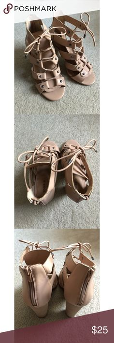 Torrid nude lace up heel Torrid nude lace up faux leather heels. Such a cute pair of heeled sandals. Only worn once! In great condition. They pair really well with dresses or skinny jeans. These are a size 9 WIDE. torrid Shoes Heels