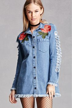 A denim shirt dress featuring floral embroidered appliques on the chest, frayed trim along the long sleeves and hem, a buttoned placket, basic collar, and front patch pockets. This is an independent brand and not a Forever 21 branded item.
