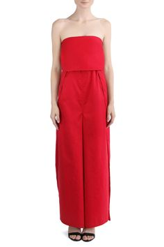 Red, strapless jumpsuit that ties on at the back and front under bust. Three ties on the garment allow for a custom fit and roomy flow.