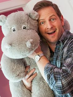 While putting the finishing touches on a newly renovated bedroom, Sledgehammer host Jason Cameron has a some fun taking a photo with a stuffed hippo.