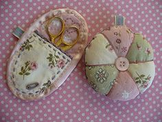 sweet pincushion and scissor keeper...love the soft colors and embroidery touches