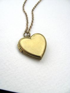 Heart locket necklace on antiqued gold metal by MySoCalledVintage, $24.00