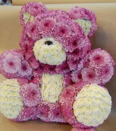 Valentine's Day Flowers. Cute floral teddy bear. Made of real flowers. Mums. We can make it for you. Baby shower centerpiece. https://www.facebook.com/FloralPlush
