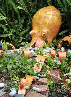 Outdoor ceramic octopus sculpture with tentacles that weave through the garden.@Wabisabi Green #ceramics #octopus #ceramicsculpture