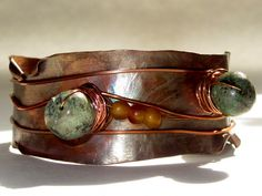 Tribal copper cuff  with an unusual green diorite and 3 small seed beads; copper wired to give a rustic look. by AndreaDurhamDesigns at Etsy.