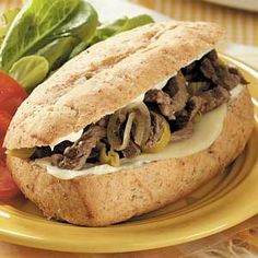 "Italian Sirloin Beef Sandwiches -- At my house, we call this slow-cooker recipe ""Where's the Beef?"" It's a potluck and party staple for me all year round, and it freezes beautifully, too. It's just so easy to throw together, and after simmering all day in the slow cooker, the beef just melts in your mouth. -Catherine Cassidy"