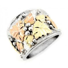 Black Hills Gold Wedding Landstroms Black Hills Gold Leaves on Silver Mens / Womans Unisex Ring - Size - Black Hills Gold on sterling silver Decorated with gold leaves Width: inch Made in USA I Love Jewelry, Jewelry Shop, Silver Jewelry, Silver Rings With Stones, Gold Rings, Black Hills Gold Jewelry, Jewelry Photography, Luxury Jewelry, Rings For Men