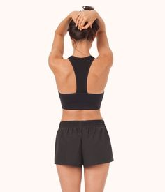c7b19593780e9 Hit the ground running in this racerback sports bra. Talk about a total  stunner. Fabric has a sweat-wicking finish. Recommended Sizing  XS S M L  Our girls ...