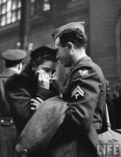 A soldier consoles his weeping wife as he says goodbye.  Penn Station, New York, 1944
