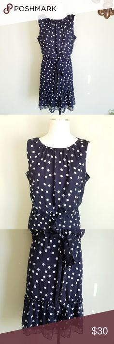 "Dress Barn Navy Polka Dot Ruffle Dress Dress Barn. Women's 16. Stretch. Sleeveless Tie Waist Dress. Navy blue and white polka dot pattern. Sleeveless top. Pleated neckline. Elastic / drawstring belted waist. Key hole back.  Ruffled skirt. Sheer chiffon fabric - Fully lined.  Excellent condition! Bust- Length- 22.5"" Length- 40"" Waist- 18.5"" Dress Barn Dresses"