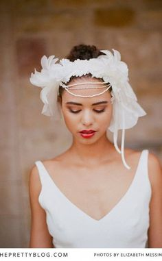 beautiful vintage inspired bridal look with simplistic white dress and feathered headpiece