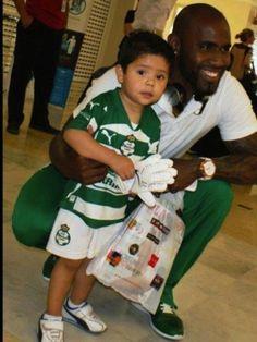 Santos Laguna Felipe Baloy poses with kid and Playboy issue