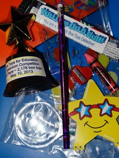 The goodie bags each student received with thei trophy contained a pencil, pencil sharpener, eraser, mini notebook, magnifying glass (for my box tops detectives to find more box tops) and a fruit roll up snack.