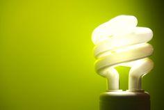 an energy saving light bulb on a green background. Energy Bill, Changing Jobs, Alternative Energy, Green Backgrounds, Solar Energy, Solar Power, Energy Efficiency, Save Energy, Light Bulb