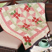 "Little Blossoms Quilt by Diane Nagle.  Add a dash of spring to your home with this versatile quilt. Use it as a table topper, wallhanging, or throw. Size: 48"" × 48"" Blocks: 4 (12"") Pinwheel blocks. http://www.fonsandporter.com"