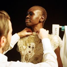 Marc Jacobs makes final adjustments on Alek Wek's gown before she hits the runway at New York Fashion Week.