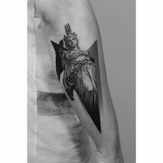 Dotwork Athena tattoo on the forearm.