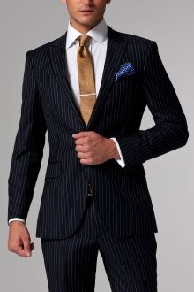A sophisticated pinstripe suit is every businessman's best friend. Whether you're looking for a serious chalk stripe or dandyish multi-hue track stripe, our catalogue of custom suits boasts a wide variety of pinstripe suits. Navy Pinstripe Suit, Made To Measure Suits, Dinner Suit, Best Dressed Man, Black Leather Dresses, Three Piece Suit, Tailored Suits, Fashion Night, Fashion Ideas
