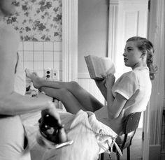 Girls Ironing and Reading 1958 Photo: Genevieve Naylor