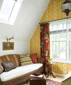Patterned yellow wallpaper, mismatched vintage fabrics, and beaded 6-inch wall paneling soften this lofty, light-filled study.   Paint: @benjamin_moore Decorator's White