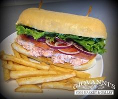 Loaded with our delicious Smoked Salmon, Fresh Lettuce, Sliced Red Onions, Chopped Tomatoes, and our Homemade Tartar Sauce served on a Sourdough Roll. Smoked Salmon Sandwich, Sourdough Rolls, Homemade Tartar Sauce, Oysters, Lettuce, Onions, Tomatoes, Steak, Sandwiches