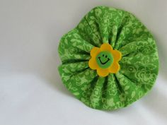 Smiling Flower Handstitched yo yo hair clip by ThisandThatCrafter