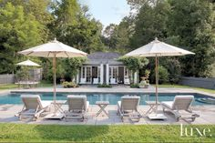 Janus et Cie chaises face the new pool house, which the landscape designer planted with wisteria vines. Around hardscaping by Rolando Sandoval, Marshall employed easy-maintenance, deer-resistant plants such as cotinus, viburnum and lady's mantle.