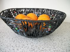 Fruitbasket. Used a hanging basket frame and inner tube rubber from a bike and some beads with a big hole.