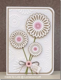 handmade card ... kraft base with white top layer ... embossing folder texture matches the dies so can place the flowers exactly over the matched embossed one ...