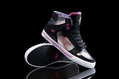 The Vaider high top upper is enveloped in an iridescent snakeskin embossed suede which is complemented by a deep black suede and pink accents. Maurizio Molin's printed nylon can be found lining the padded interior.