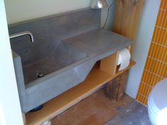 This Concrete Sink Has A Large Basin.