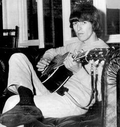 George Harrison relaxing with his guitar at his home Kinfauns in the 60s