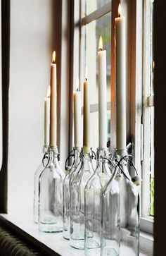 Photo of bottles with taper candles - great idea!  The Little Corner