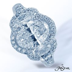 JB Star Magnificent handcrafted platinum diamond ring featuring a 2.01 oval diamond embraced by two oval diamonds, edged with micro pave, plus additional round diamonds set in a channel down the shank.